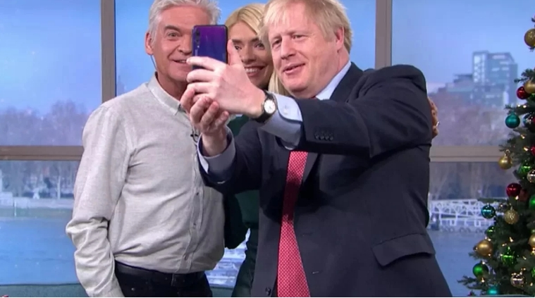 TheThe PM of Great Britain Boris Johnson scared special services of selfie from the smartphone Huawei Prime Minister of Great Britain scared special services of selfie from the smartphone Huawei